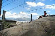Boy looks out over the hills from Complexo do Alemao, Rio de Janeiro. 2006