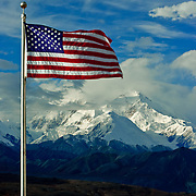 The American Flag waves at Denali (Mt. McKinley), highest mountain in all of North America on Sept. 11, 2011, the tenth anniversary of the 9/11 attacks.