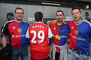 a group of FC Basel fans look on at an Arsenal fan wearing his Granit Xhaka of Arsenal shirt. outside Emirates Stadium before k/o.  UEFA Champions league group A match, Arsenal v FC Basel at the Emirates Stadium in London on Wednesday 28th September 2016.<br /> pic by John Patrick Fletcher, Andrew Orchard sports photography.