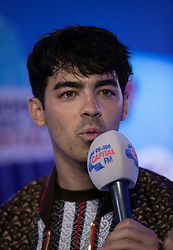Joe Jonas of The Jonas Brothers in the on air studio during Capital's Summertime Ball. The world's biggest stars perform live for 80,000 Capital listeners at Wembley Stadium at the UK's biggest summer party.