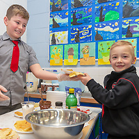 Alex Foster buying the pancakes from Ronan Kilroy at the Jessies Fruity Express showcase day at Ennis National school
