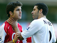 13/11/2004 - FA Barclays Premiership - Tottenham Hotspur v Arsenal - White Hart Lane<br /> Tottenham's Nourredine Naybet holds Arsenal's Francesc Fabregas around the neck<br /> Photo:Jed Leicester/Back page images<br /> NORWAY ONLY