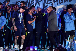 Manchester City manager Pep Guardiola with Sergio Aguero and Bernardo Silva on stage during the celebrations at the Etihad Stadium after securing the Premier League title earlier in the day with their win at Brighton and Hove Albion.