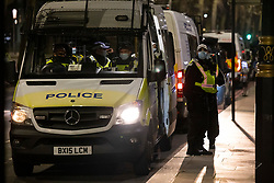 © Licensed to London News Pictures. 31/12/2020. London, UK. Police vans are parked the mostly quiet Embankment ahead of midnight and a muted New Year's Eve in central London. Photo credit: Peter Macdiarmid/LNP