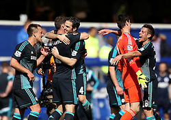 Chelsea's Cesc Fabregas celebrates with Chelsea's Branislav Ivanovic and Chelsea's Cesar Azpilicueta celebrates with Chelsea's Thibaut Courtois - Photo mandatory by-line: Robbie Stephenson/JMP - Mobile: 07966 386802 - 12/04/2015 - SPORT - Football - London - Loftus Road - Queens Park Rangers v Chelsea - Barclays Premier League