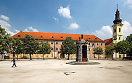 Jelacic Square, with a well at its centre and damaged palace (originally the site of an armoury), in the old fortified town of Karlovac, Croatia. Karlovac was fortified during the 16th century on the plan of a six-pointed star.