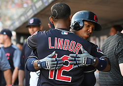 May 31, 2018 - Minneapolis, MN, U.S. - MINNEAPOLIS, MN - MAY 31: Cleveland Indians Third base Jose Ramirez (11) is hugged by Cleveland Indians Shortstop Francisco Lindor (12) after hitting a solo home run in the top of the 4th during a MLB game between the Minnesota Twins and Cleveland Indians on May 31, 2018 at Target Field in Minneapolis, MN. The Indians defeated the Twins 9-8.(Photo by Nick Wosika/Icon Sportswire) (Credit Image: © Nick Wosika/Icon SMI via ZUMA Press)