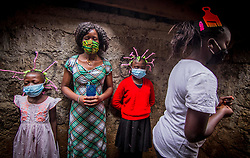 May 9, 2020: Kenya: Young Girls from Kibera Slums use their Corona Virus braided hair style in spreading awares to the society. (Credit Image: © Donwilson Odhiambo/ZUMA Wire)