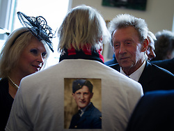 """© Licensed to London News Pictures . 14/10/2013 . Gorton Monastery , Manchester , UK . Footballer DENIS LAW (right) talks to a friend wearing a t-shirt with """" That's a Rembrandt """" as a tribute to Harry . The Humanist funeral of photographer Harry Goodwin , attended by footballers and other celibrities and featuring music by artists he had photographed including """"He Ain't Heavy, He's My Brother"""" by the Hollies and """" Happiness """" by Ken Dodd . Photo credit : Joel Goodman/LNP"""