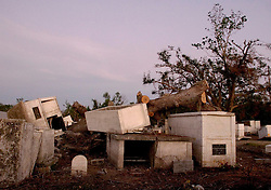 03 November, 2005. New Orleans, Louisiana. Post Katrina. <br /> Merrick Cemetery, St Bernard Parish just outside New Orleans, Louisiana in the aftermath of Hurricane Katrina. FEMA contractors are still removing coffins from the graveyard destroyed by the storm. Merrick cemetery was one of the earliest slave cemeteries in the south and was deluged by 20ft of flood water.<br /> Photo; ©Charlie Varley/varleypix.com