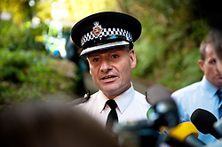 © licensed to London News Pictures  15/09/2011 . Pontardawe,UK...Picture: Superintendent Phill Davies Speaks at press conferance held at the end of a lane around two miles away from trapped miners. .. An operation in underway to rescue four miners trapped in a mine in the Swansea Valley. Photo credit :Aled Llywelyn/LNP