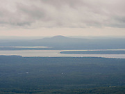 View of Blue Hill and WesternBay from Cadillac Mountain on an overcast day, Mount Desert Island, Acadia National Park, Maine, USA.