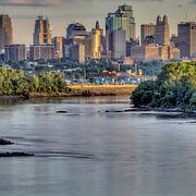 Kansas City Missouri downtown skyline and Missouri River view at dusk from Chouteau Trafficway Bridge.