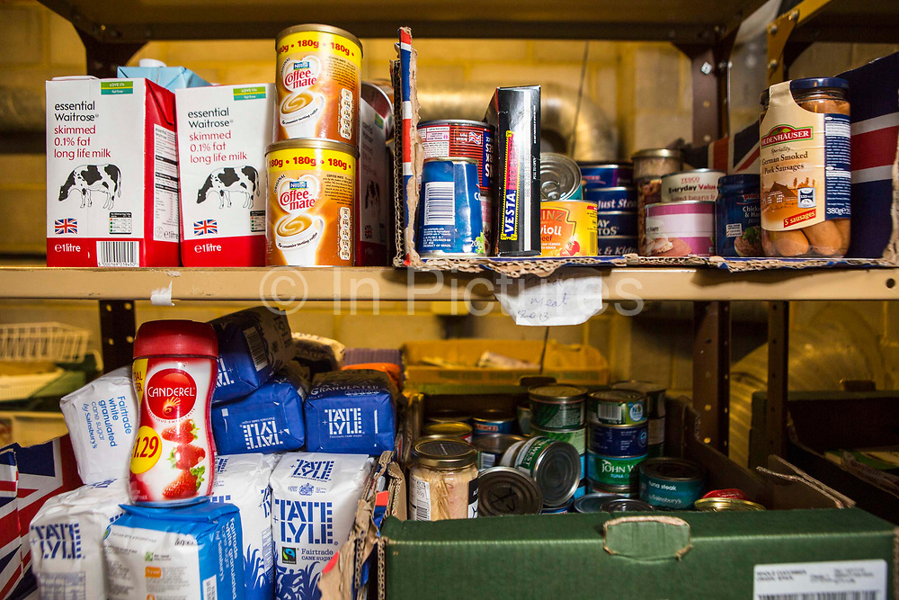 Non-perishable food donated by members of the public on the selves at the Trussell Trust's Kingston Foodbank, Kingston, United Kingdom.  Every day people in the UK go hungry for reasons ranging from redundancy to receiving an unexpected bill on a low income. Trussell Trust foodbanks provide a minimum of three days emergency food and support to people experiencing crisis.  In 2012-13 foodbanks fed346,992 people nationwide. Of those helped, 126,889 were children.  In response to the Government cuts to welfare, foodbanks have experienced a significant increase in demand and in September 2013, Kingston foodbank provided food for their 5,000th person.  Food is collected from schools, churches, businesses and individuals, who donate non-perishable, in-date food, such as UHT milk, sugar, tuna.