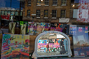 Mirrored construction and regeneration hoardings featuring local arts and community on 7th March 2017, on Station Square, Railton Road in Herne Hill, SE24, London borough of Lambeth, England. The small Victorian-era shops in Station Square, Herne Hill is undergoing a regeneration of its railway arches and local businesses have been closed by their Network Rail owners, part of the gentrification of the area which has attracted opposition and controversy.