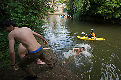 © licensed to London News Pictures. 01/05/2011. Oxford, UK. Oxford Brookes student swim in the River Cherwell underneath the Magdalen Bridge bridge in Oxford, Oxfordshire today (01/05/02011) as part of  May Day celebrations. Revelers where prevented from jumping from the bridge which is tradition. Please see special instructions for usage rates. Photo credit should read Ben Cawthra/LNP