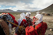 Moving with the Khan (chief) family. Tella Bu, daughter of the late Khan, is greeted with a kiss, arriving from the Qyzyl Qorum winter camp to the summer camp of Kara Jylga, on the south side of the wide Little Pamir plateau...Trekking through the high altitude plateau of the Little Pamir mountains (average 4200 meters) , where the Afghan Kyrgyz community live all year, on the borders of China, Tajikistan and Pakistan.