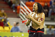 4/12/2007 - Former Arizona Cardinal Mao Tosi, who is now a security guard at West Anchorage High School, performs with his high school student Polynesian Pride club before the Intense Football League debut for The Alaska Wild and the Frisco Thunder in the first professional football game in Alaska.