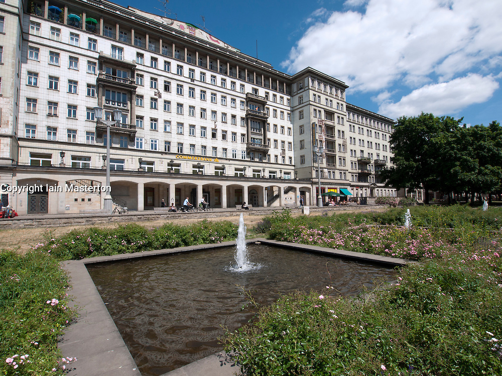 Fountain in front of historic old apartment building on Karl Marx Allee in former East Berlin in Germany