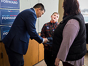 22 JANUARY 2020 - CHARLES CITY, IOWA: ANDREW YANG talks to a mother and her son after Yang spoke at a campaign event in the public library in Charles City, IA. Yang, an entrepreneur, is running for the Democratic nomination for the US Presidency in 2020. He is in northern Iowa as a part of his 17 day bus tour across the state. Iowa hosts the the first election event of the presidential election cycle. The Iowa Caucuses will be on Feb. 3, 2020.         PHOTO BY JACK KURTZ
