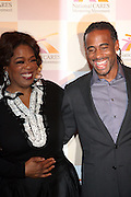 l to r: Oprah Winfrey and Jeff Johnson at The National CARES Mentoring Movement Gala held at ESPACE on December 2, 2008 in NYC..National CARES is a mentor-recruitment movement that works ti fill the pipeline of youth-supporting organizations throughout the country with mentors. Its mission is to save a generation by outting a caring adult in the life of every at-risk child and those who have already fallen in peril.