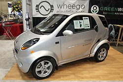 08  February 2013: 2013 Life Wheego electric vehicle. Chicago Auto Show, Chicago Automobile Trade Association (CATA), McCormick Place, Chicago Illinois<br /> <br /> All electric, not a hybrid. Range is approximately 40 miles per charge with charging time around 10 hours on 120 v.  Two seats plus cargo room.  Standard equipment includes power assisted front disc and rear drum brakes, proportional regenerative braking system, manual 4 way adjustable driver seat, am/fm CD with MP3/usb, rear window defroster, power locks, keyless entry, electric outside mirrors, 96v discovery batteries, windshield defroster, power windows, power steering and eco meter.  Air conditioning, dual charging stem and spare tire carrier are optional.