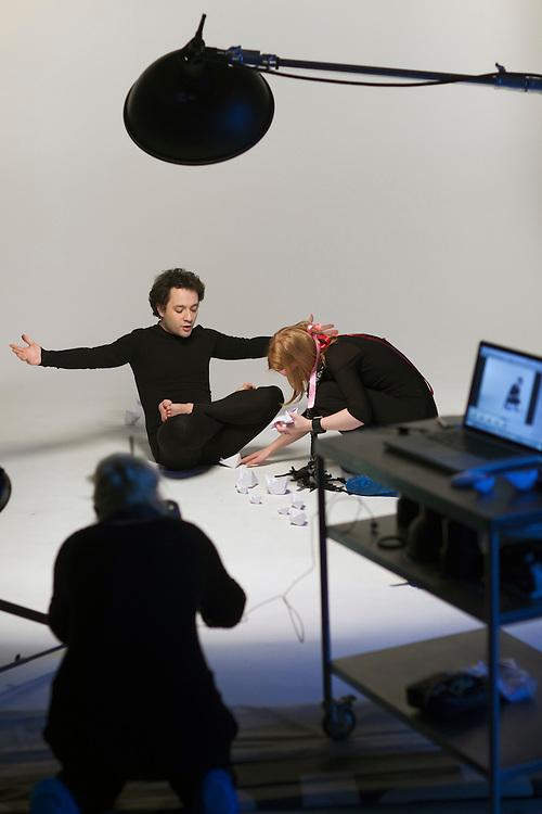 Moscow, Russia, 11/02/2011..Producer Elena Kashirskaya prepares Snob magazine journalist Ilya Kolmonovski during studio shoot in which Kolmonovski enacts parts of the human body..