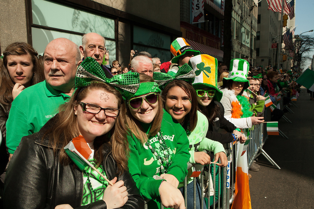 Parade watchers in green.