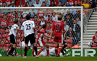Fotball<br /> England 2005/2006<br /> Foto: SBI/Digitalsport<br /> NORWAY ONLY<br /> <br /> FA Barclays Premiership<br /> Middlesbrough v Charlton<br /> 28/08/2005.<br /> <br /> Charlton's Chris Perry bundles the ball into he back of the net for Charlton's second goal.