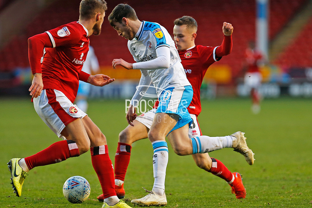 Ashley Nadesan goes past Liam Kinsella during the EFL Sky Bet League 2 match between Walsall and Crawley Town at the Banks's Stadium, Walsall, England on 18 January 2020.