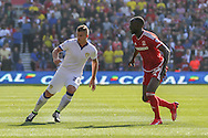 Leeds United defender Gaetano Berardi    and Middlesbrough midfielder Albert Adomah during the Sky Bet Championship match between Middlesbrough and Leeds United at the Riverside Stadium, Middlesbrough, England on 27 September 2015. Photo by Simon Davies.