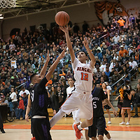 Gallup Bengals guard Isaac Bustinza (12) tries a jump shot near the baseline against heavy defending by Miyamura Patriots Gabe Lee jr. (10) during the 4A -District Tournament Championship game at Gallup High School Saturday.