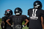 Kids warm up before football practice with Truth, a youth sports organization founded by Deion Sanders, at the Prime Prep Academy campus in Dallas, Texas on August 6, 2014. (Cooper Neill for The New York Times)