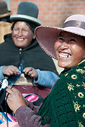 Bolivia June 2013. Cajamarca. Meeting with women. Two women laughing and smiling as they knit.