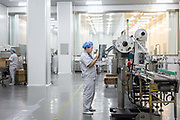 An employee operates on a production line that makes health supplements inside a Tiens Group manufacturing facility in Tianjin, China on Tuesday, Aug. 9, 2016. Tiens is a direct sales firm specializing in health and beauty products.