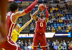 Feb 2, 2019; Morgantown, WV, USA; Oklahoma Sooners guard Christian James (0) shoots a three pointer during the first half against the West Virginia Mountaineers at WVU Coliseum. Mandatory Credit: Ben Queen-USA TODAY Sports