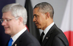 © Licensed to London News Pictures. 05/06/2014. Brussels, BELGIUM.<br /> Barack Obama (R) and stephen harper enter the room for the G7 SUMMIT Family Photo, 5/6/2014<br /> Photo credit : RICH BOWEN/LNP