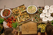 Dinner buffet table laid out with an assortment of food at an evening event