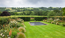 View over the Bronze Garden at Holt Farm towards countryside beyond