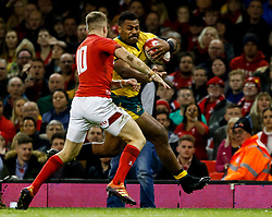 Samu Kerevi of Australia is tackled by  Gareth Anscombe of Wales<br /> <br /> Photographer Simon King/Replay Images<br /> <br /> Under Armour Series - Wales v Australia - Saturday 10th November 2018 - Principality Stadium - Cardiff<br /> <br /> World Copyright © Replay Images . All rights reserved. info@replayimages.co.uk - http://replayimages.co.uk