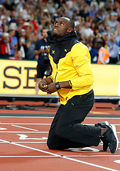 LONDON, Aug. 14, 2017  Usain Bolt of Jamaica kneels at the finish line of 100m on Day 10 of the 2017 IAAF World Championships at London Stadium in London, Britain, on Aug. 13, 2017. (Credit Image: © Wang Lili/Xinhua via ZUMA Wire)