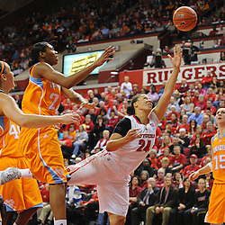 Rutgers Scarlet Knights guard/forward April Sykes (24) shoots a layup under Tennessee Lady Volunteers forward/center Vicki Baugh (21) and Tennessee Lady Volunteers forward Alicia Manning (15) during second half NCAA Women's Basketball action between the Rutgers Scarlet Knights and Tennessee Lady Volunteers at the Louis Brown Athletic Center. Tennessee defeated Rutgers 67-61.