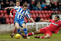 Photo: Leigh Quinnell.<br /> Swindon Town v Chester City. Coca Cola League 2. 24/02/2007. Swindons Jerel Ifil gets a challenge in on Chesters Chris Holroyd.