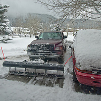 A private snowplow clears a driveway after a storm near Bozeman, Montana.