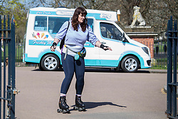 © Licensed to London News Pictures.04/04/2021. London, UK. A woman rides on roller skates on Easter Sunday in Victoria Park, east London. Photo credit: Marcin Nowak/LNP