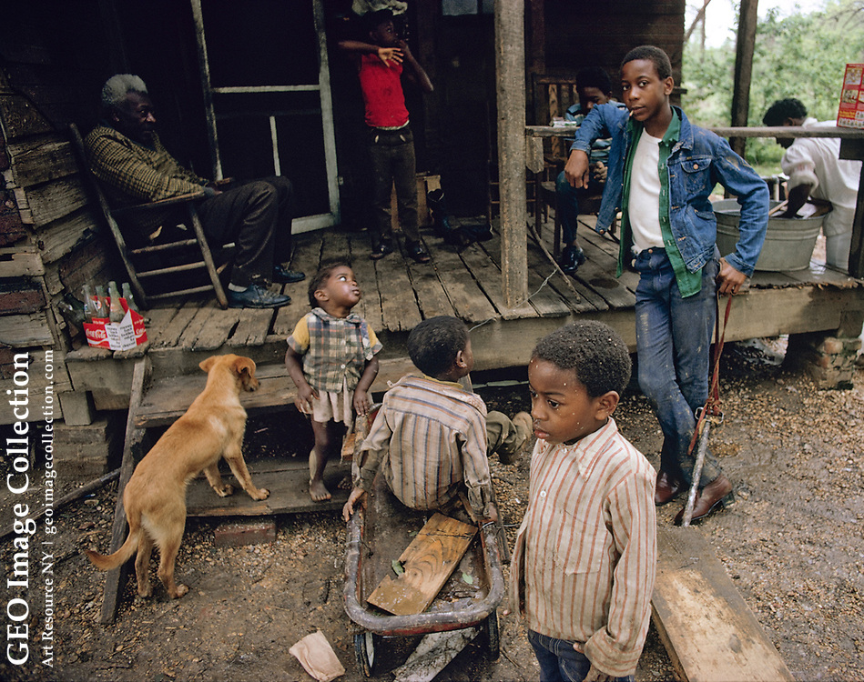 """Home of Jeff Howard, 62, put off sharecropper plantation about 1965 but """"I don't know just when."""" He was kicked off farm when last owner of plantation died, and owner's son didn't want to keep sharecroppers so he put off 8 families. Now lives in Pattison, a bleak ghetto suburb of Port Gibson, MS. Pattison is a very poor unincorporated village with high poverty and underprivileged African-American population. The tumbledown shack is not much better than days of slaves and sharecroppers."""