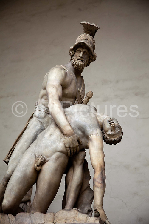 Menelaus Patroclus, Romano Greek statue in the Loggia dei Lanzi, Florence.<br /> Menelaus bearing the corpse of Patroclus. Marble, Roman copy of the Flavian Era after a Hellenistic original of the 3rd century BC, with modern restorations. Found in Rome; in the Medici collections in Florence, 1570; installed in the Loggia dei Lanzi since 1741.<br /> Piazza della Signoria is an L-shaped square in front of the Palazzo Vecchio in Florence, Italy. It was named after the Palazzo della Signoria, also called Palazzo Vecchio.<br /> It is the focal point of the origin and of the history of the Florentine Republic and still maintains its reputation as the political hub of the city.It is the meeting place of Florentines as well as the numerous tourists, located near Ponte Vecchio and Piazza del Duomo and gateway to Uffizi Gallery.<br /> The Loggia dei Lanzi consists of wide arches open to the street, three bays wide and one bay deep. The arches rest on clustered pilasters with Corinthian capitals. The wide arches appealed so much to the Florentines, that Michelangelo even proposed that they should be continued all around the Piazza della Signoria<br /> It is effectively an open-air sculpture gallery of antique and Renaissance art including the Medici lions.