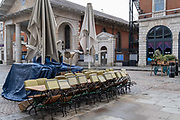 According to the governments Covid social distance restrictions, tables and chairs from a closed restaurant business Laduree are stacked and tied together in the Covent Garden Piazza during the third lockdown of the Coronavirus pandemic, on 3rd February 2021, in London, England.