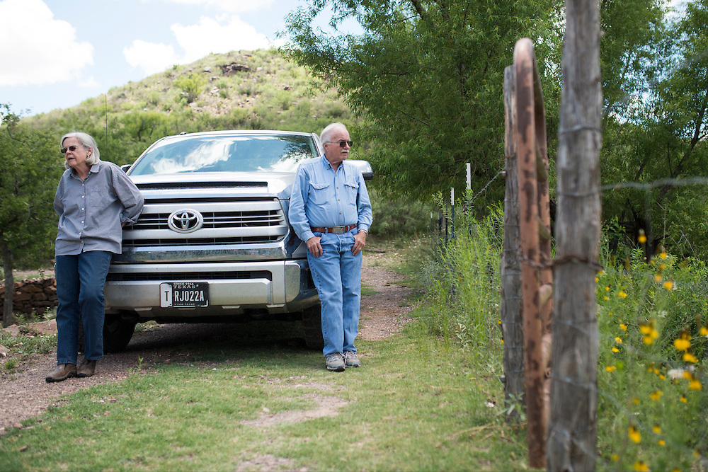 Former Brewster County Judge Val Beard and her husband Tom look out over a natural spring on their ranch near Alpine, Texas on June 17, 2015. (Cooper Neill for The Texas Tribune)