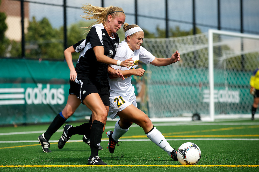 Vermont forward Bre Pletnick (21) battles for the ball during the women's soccer game between the Brown Bears and the Vermont Catamounts at Virtue Field on Saturday afternoon September 8, 2012 in Burlington, Vermont.
